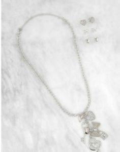 Charm necklace with 3 pairs of earrings.